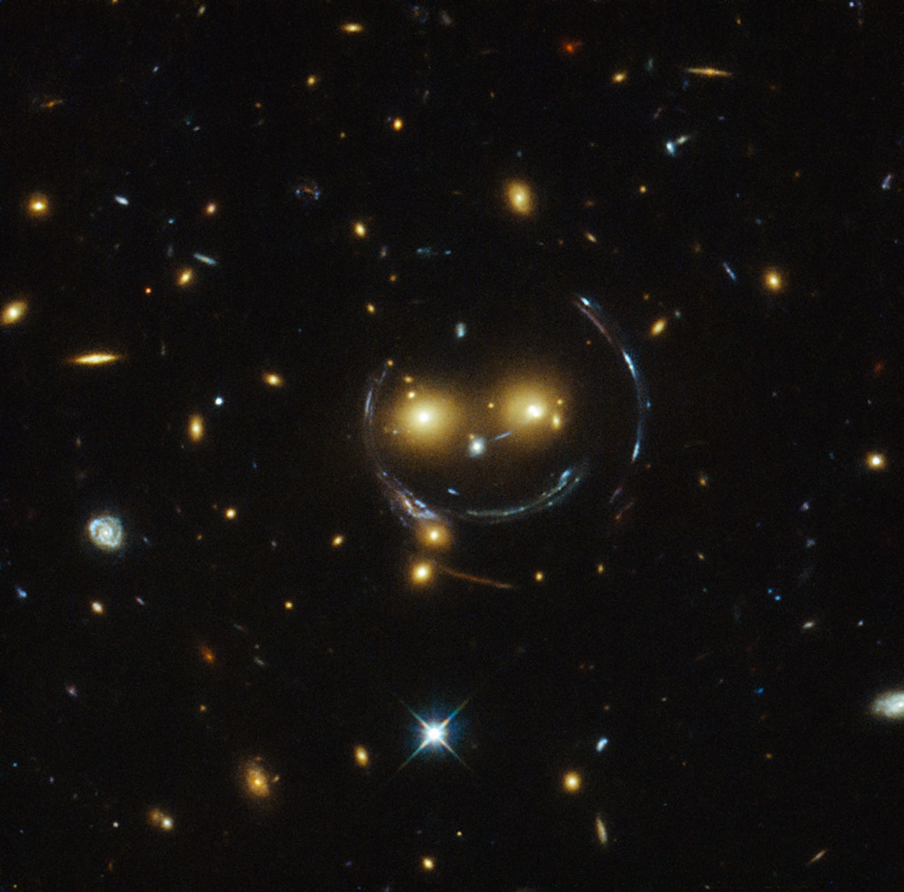 Hubble Spots a Cluster of Galaxies That Looks like a Massive Smiley Face