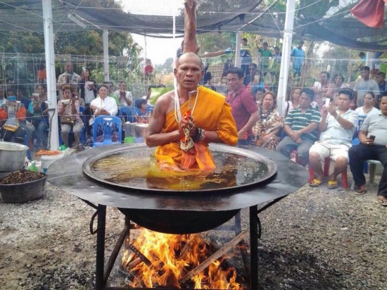 Thai Monk Meditates in Pot of Boiling Oil over an Open Flame