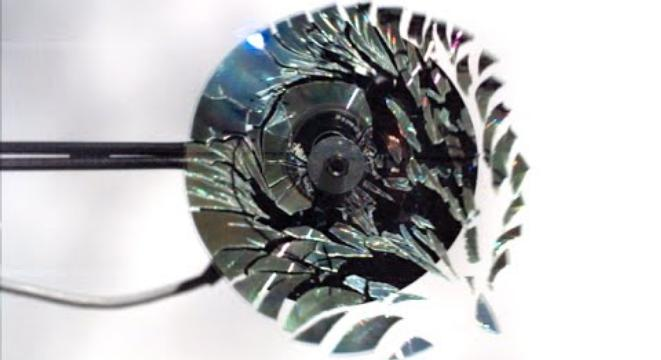 A CD Shattered By Rotational Speed, Filmed At 170,000fps