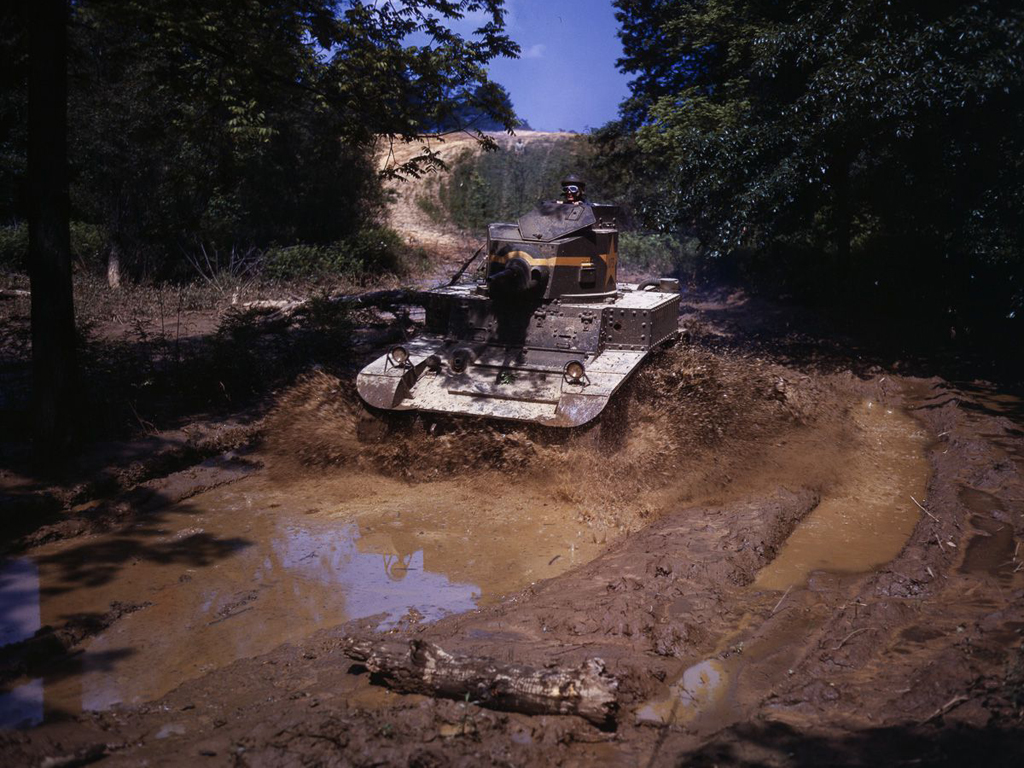 Life at Fort Knox in 1942 - 6. An M3 Stuart light tank hits a water obstacle with full force.